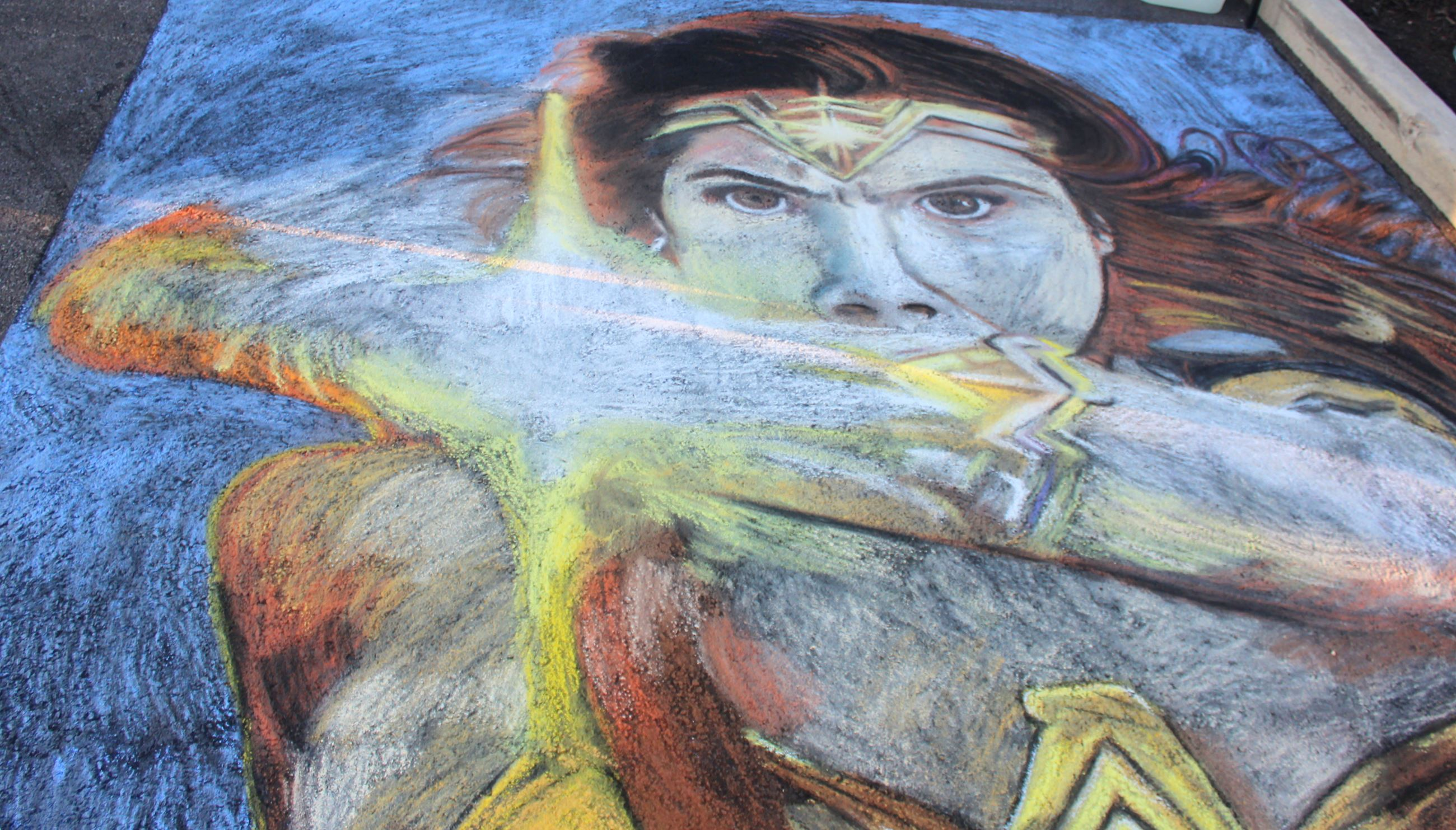 Photo of featured artist chalk art