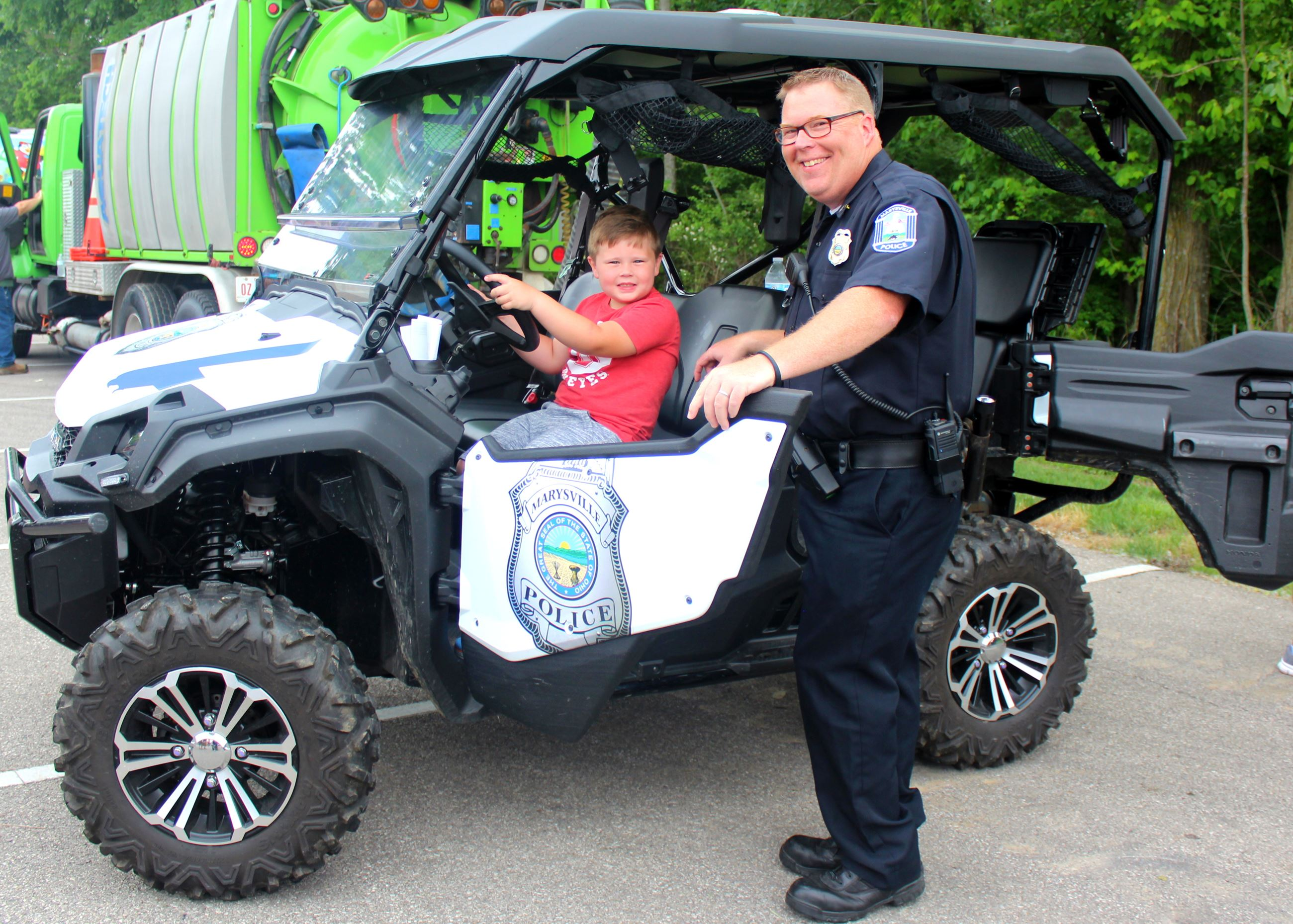 Photo of small boy and Sgt McGlenn in Police UTV