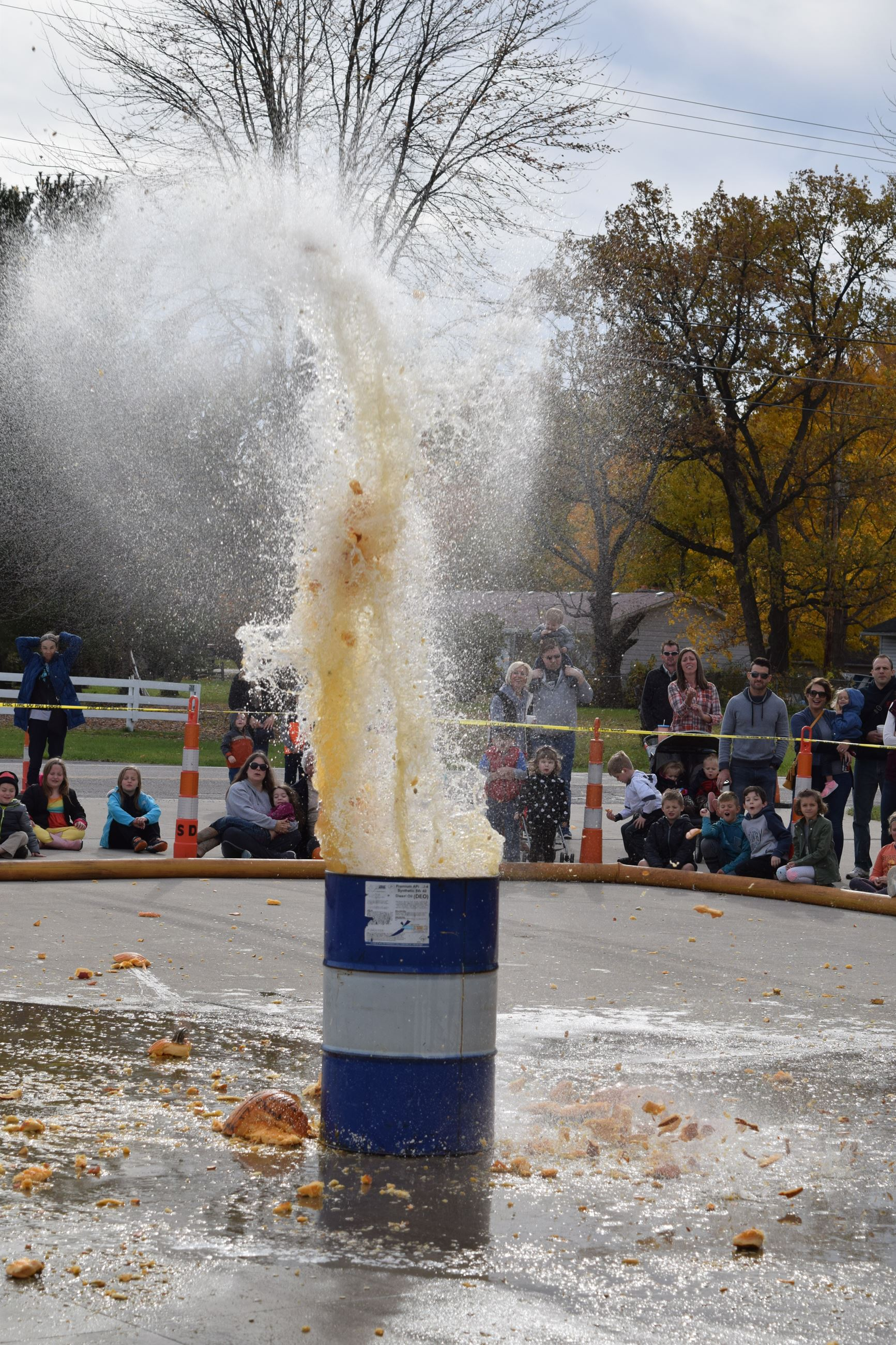 Photo of pumpkin splashing into barrel of water