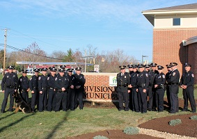 Photo of MPD Officers in front of new building